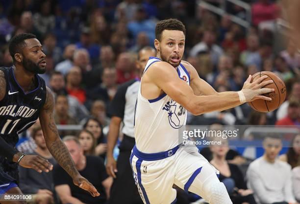 Orlando Magic forward Jonathon Simmons left defends Golden State Warriors guard Stephen Curry at Amway Center Friday Dec 1 2017 The Warriors beat the...