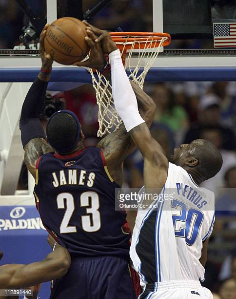 Orlando Magic forward Mickael Pietrus tries to block a shot by Cleveland Cavaliers' LeBron James in the first half of Game 4 in the NBA Eastern...