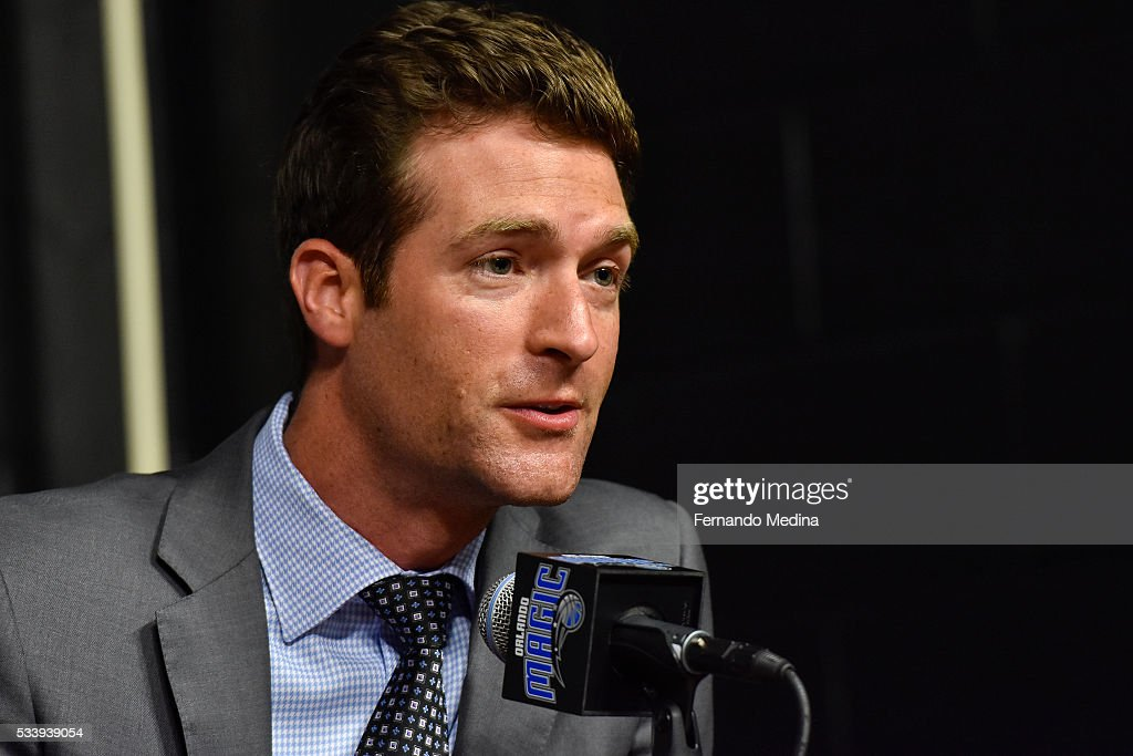 Orlando Magic general manager Rob Hennigan introduces new head coach Frank Vogel during a press conference on May 23, 2016 at Amway Center in Orlando, Florida.