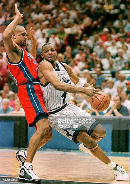 Orlando Magic guard Anfernee Hardaway drives past Detroit Pistons forward Grant Hill during the second period of their first round playoff game at...