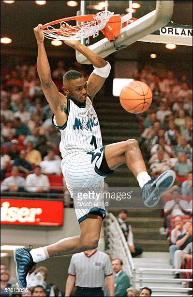 Orlando Magic guard Anfernee Hardaway slam dunks the ball during the first period of game three of the first round playoffs with the Miami Heat at...