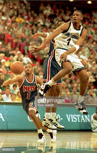 ORLANDO FL JANUARY 4 Orlando Magic guard Anfernee Hardaway takes to the air to make a pass after New Jersey Nets foreword Chris Morris applied...