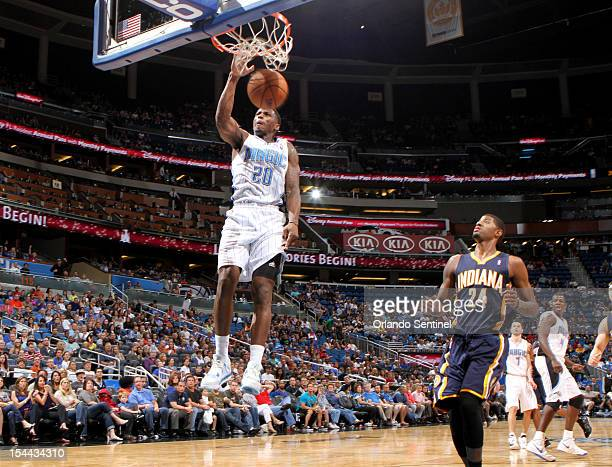 Paul george basketball player stock photos and pictures getty images orlando magic guard dequan jones dunks over indiana pacers guard paul george on the fast break voltagebd Image collections