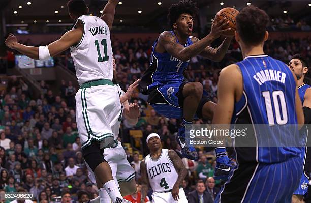 Orlando Magic guard Elfrid Payton looks for room to shoot as he drives past Boston Celtics guard Evan Turner during the third quarter The Boston...