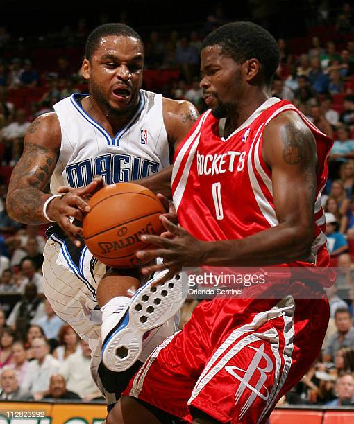 Orlando Magic guard Jameer Nelson left is fouled by Houston Rockets guard Aaron Brooks during preseason action at Amway Arena in Orlando Florida...
