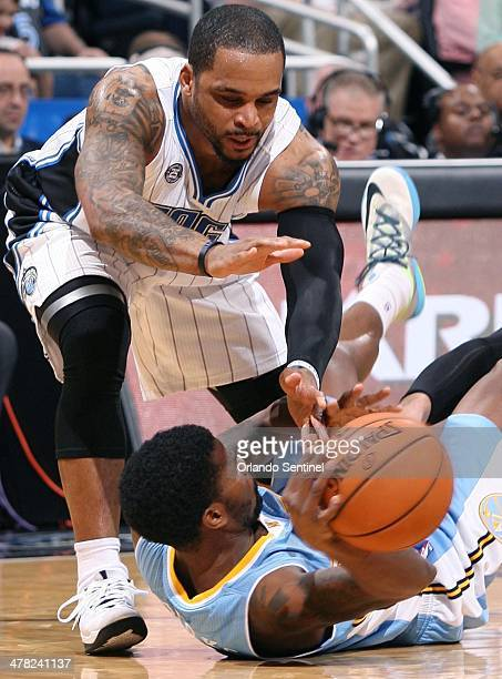 Orlando Magic guard Jameer Nelson top battles Denver Nuggets guard Aaron Brooks bottom for the ball at the Amway Center in Orlando Fla on Wednesday...