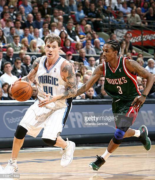 Orlando Magic guard Jason Williams dribbles around Milwaukee Bucks rookie Brandon Jennings during their NBA game Wednesday December 30 at the Amway...