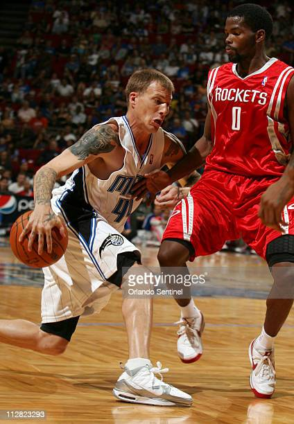 Orlando Magic guard Jason Williams left drives past Houston Rockets guard Aaron Brooks during preseason action at Amway Arena in Orlando Florida...