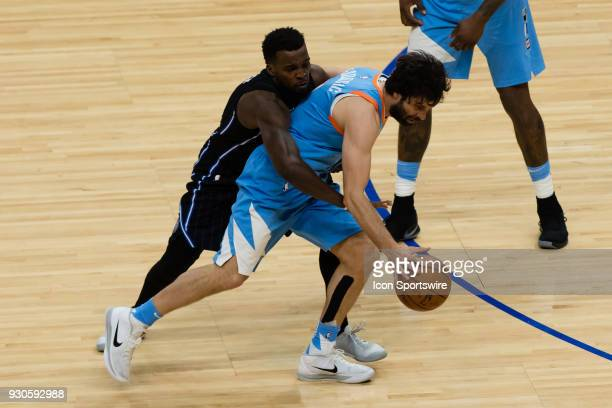 Orlando Magic guard Shelvin Mack wraps up LA Clippers guard Milos Teodosic as he dribbles the ball up court during the game between the Orlando Magic...