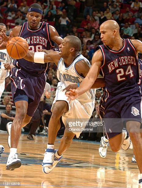 Orlando Magic guard Steve Francis tries to control the ball in front of New Jersey Nets forwards Richard Jefferson and Clifford Robinson during game...