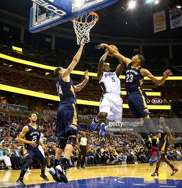Orlando Magic guard Victor Oladipo is blocked by the New Orleans Pelicans' Anthony Davis as he goes up to the basket in the second half at the Amway...