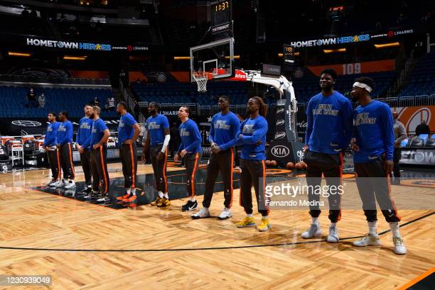 Orlando Magic players line up for the national anthem before the game against the Toronto Raptors on February 2, 2021 at Amway Center in Orlando,...