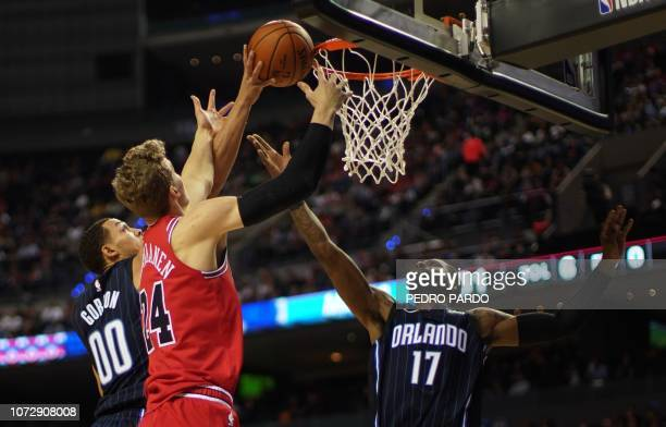 Orlando Magic's Aaron Gordon and Jonathon Simmons vie for the ball with Chicago Bulls Lauri Markkanen during an NBA Global Games match at the Mexico...