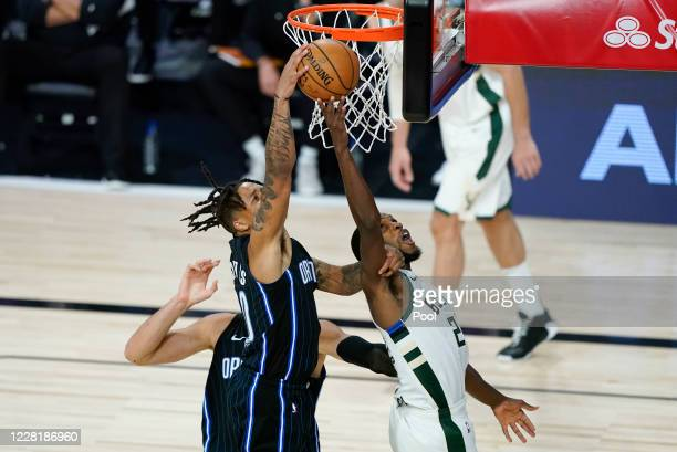 Orlando Magic's Markelle Fultz left fights for a rebound with Milwaukee Bucks' Khris Middleton during the second half of an NBA basketball first...