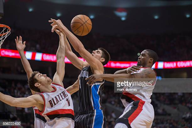 Orlando Magic's Nikola Vucevic shot is blocked by Trail Blazer Wesley Matthews