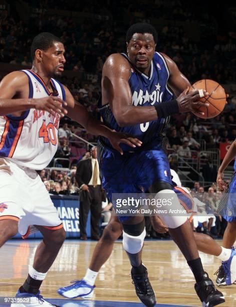 Orlando Magic's Patrick Ewing drives around New York Knicks' Kurt Thomas during action at Madison Square Garden The Magic beat the Knicks 10897 in...