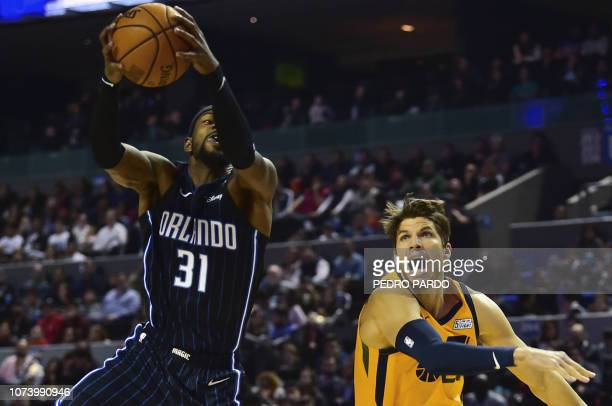 Orlando Magic's Terrence Ross vies for the ball with Utah Jazz´ Kyle Korven during an NBA Global Games match at the Mexico City Arena, on December 15...