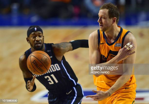 Orlando Magic's Terrence Ross vies for the ball with Utah Jazz's Joe Ingles during an NBA Global Games match at the Mexico City Arena on December 15...