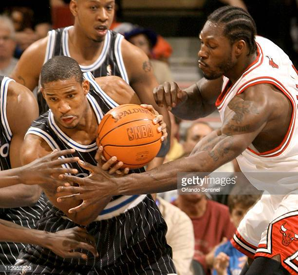Orlando Magic's Trevor Ariza fights for possession with Chicago Bulls' Ben Wallace at Amway Arena in Orlando Florida Thursday March 8 2007