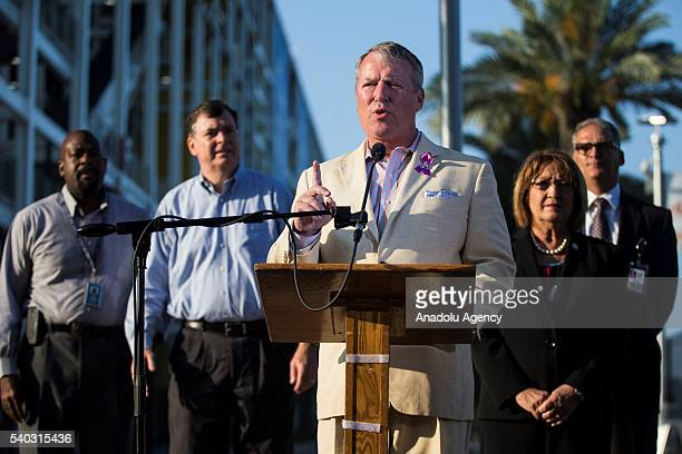 Orlando Mayor Buddy Dyer speaks during a press conference opening the Family Assistance Center at the Camping World Stadium, formerly known as the...