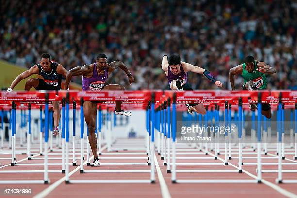 Orlando Ortega of Cuba David Oliver of the United States Xie Wenjun of China and Andrew Riley of Jamaica compete in the men's 110m hurdles during the...