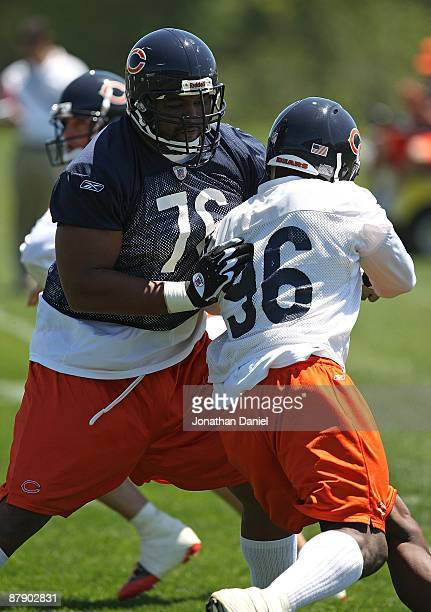 Orlando Pace of the Chicago Bears blocks Alex Brown during an organized team activity practice on May 20, 2009 at Halas Hall in Lake Forest, Illinois.