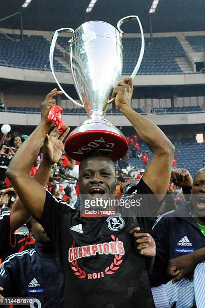 Orlando Pirates captain Lucky Lekgwathi holds aloft the premiership trophy after winning the Absa Premiership Final match between Orlando Pirates and...