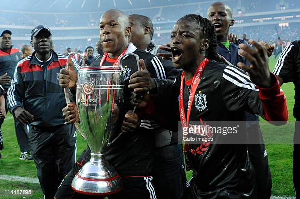 Orlando Pirates defender Happy Jele and Phenyo Mongala celebrate after winning the Absa Premiership Final match between Orlando Pirates and the...