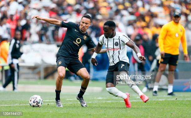 Orlando Pirates' midfielder Luvuyo Memela fights for the ball with Kaizer Chiefs' midfielder Kearyn Baccus during the Premier Soccer League match...