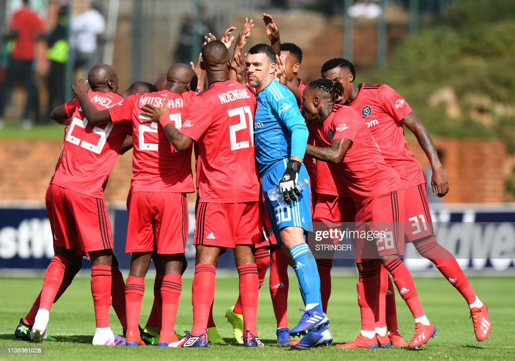 Orlando Pirates players react during the football match