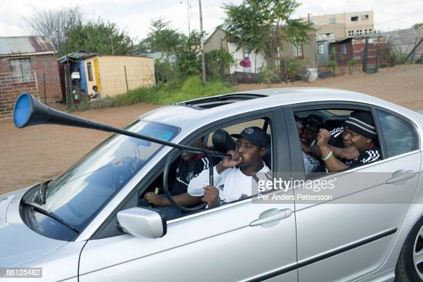 Orlando Pirates soccer supporters leave for a game in a car on May 9 in Soweto, South Africa. Diehard fans usually dress up before attending games....