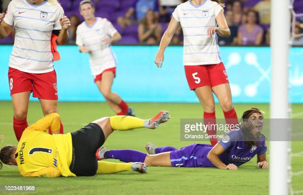 Orlando player Alex Morgan can't quite get the ball into the net beside Chicago goalkeeper Alyssa Haeher during the Chicago Red Stars at Orlando...