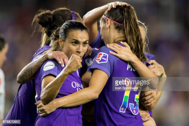 Orlando players celebrate after scoring a goal during the soccer match between The Orlando Pride and Sky Blue FC on June 16 2018 at Orlando City...