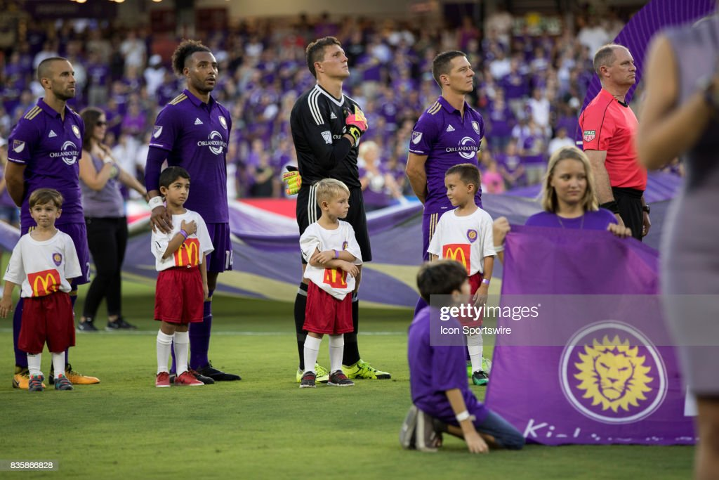 Orlando players stand for the National Anthem before the MLS soccer match between Orlando City SC and Columbus Crew FC on August 19, 2017 at Orlando City Stadium in Orlando FL.
