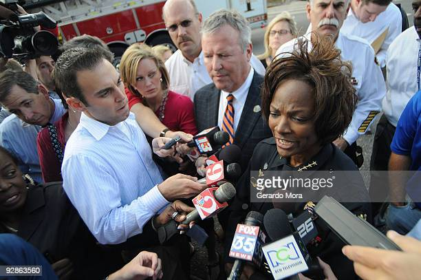 Orlando Police Chief Val Demings and Orlando Mayor Buddy Dyer , speak during a press conference near of the Legions Place office building, where a...