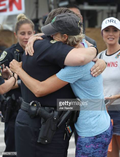 Orlando Police officer Alison Clarke receives a hug from Christine Gigicos as they attend the oneyear anniversary memorial service for victims of the...