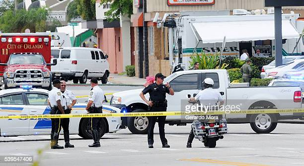 Orlando police officers seen outside of Pulse nightclub after a fatal shooting and hostage situation on June 12 2016 in Orlando Florida The suspected...