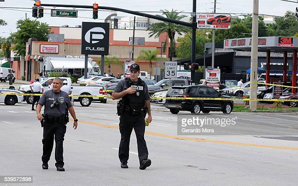 Orlando police officers seen outside of Pulse nightclub after a fatal shooting and hostage situation where 50 people died on June 12 2016 in Orlando...