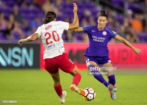 Orlando Pride defender Ali Krieger and Chicago Red Stars forward Sam Kerr meet at the ball for possession during the NWSL soccer match between the...