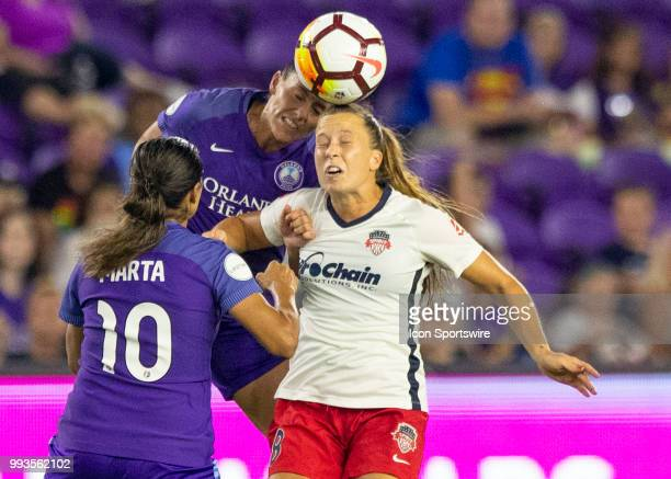 Orlando Pride defender Ali Krieger and Washington Spirit midfielder Megan Dougherty Howard challenge for a header during the NWSL soccer match...