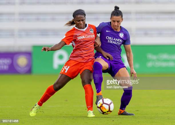 Orlando Pride defender Ali Krieger challenges Houston Dash forward Nichelle Prince during the NWSL soccer match between the Orlando Pride and the...