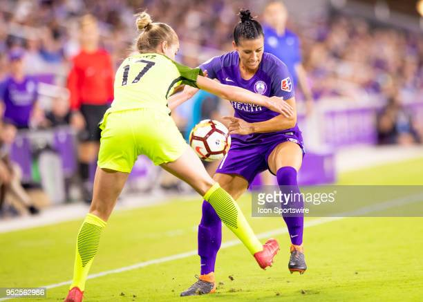 Orlando Pride defender Ali Krieger challenges Seattle Reign FC forward Beverly Yanez for the ball during the NWSL soccer match between the Orlando...