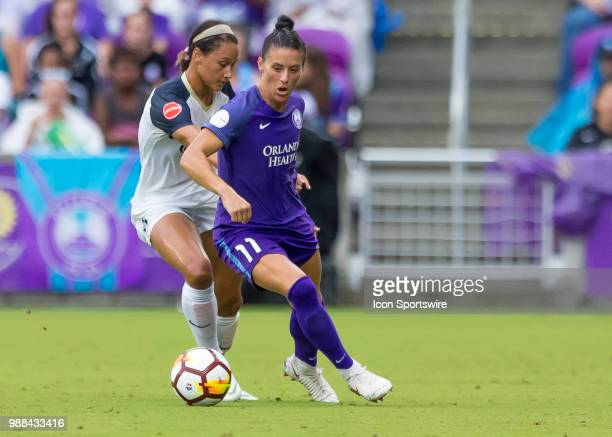 Orlando Pride defender Ali Krieger controls a pass during the NWSL soccer match between the Orlando Pride and the North Carolina Courage on June 30th...
