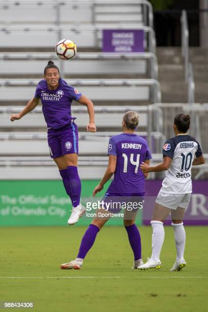 Orlando Pride defender Ali Krieger goes up for a header during the soccer match between the Orlando Pride and the NC Courage on June 30 2018 at...