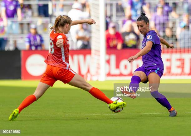 Orlando Pride defender Ali Krieger Houston Dash midfielder Claire Falknor challenge for ball possession during the NWSL soccer match between the...
