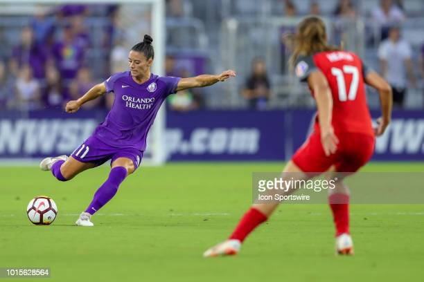 Orlando Pride defender Ali Krieger kicks the ball while being defended by Portland Thorns FC midfielder Tobin Heath during the soccer game between...