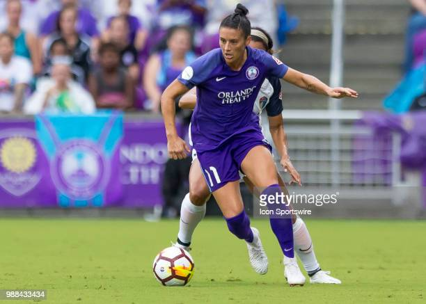 Orlando Pride defender Ali Krieger looks to pass during the NWSL soccer match between the Orlando Pride and the North Carolina Courage on June 30th...