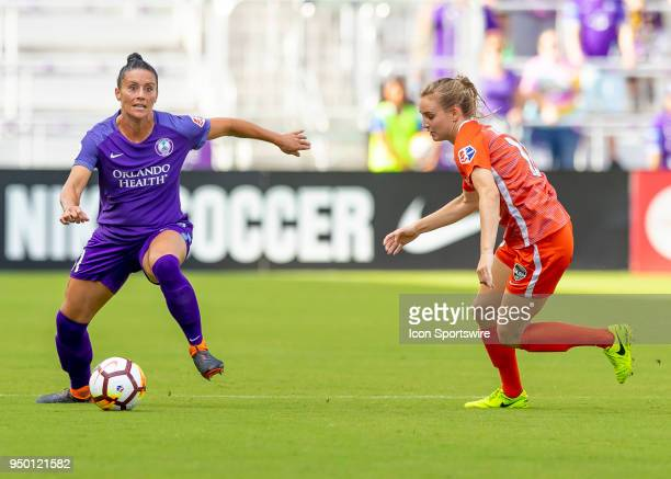 Orlando Pride defender Ali Krieger looks to pass the ball during the NWSL soccer match between the Orlando Pride and the Houston Dash on April 22...
