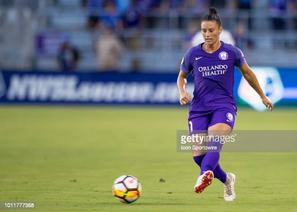 Orlando Pride defender Ali Krieger passes the ball back to Orlando Pride goalkeeper Ashlyn Harris during the NWSL soccer match between the Orlando...