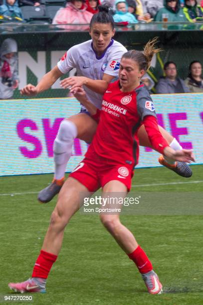 Orlando Pride defender Ali Krieger takes a cross garded by Portland Thorns defender Kelly Hubly during the first half of the Portland Thorns 21...